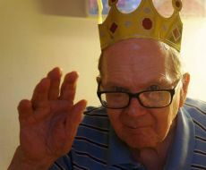 """George Russell, Jr. in a paper crown. What a silly, brilliant, fervent, righteous, private, prescient, witty, abiding man our Dad was. He loved to mockingly describe himself: """"I'm the most modest man in the whole universe."""""""